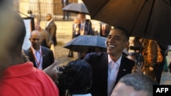 U.S. President Barack Obama talks to tourists and Cubans upon arriving at Havana Cathedral on March 20, when Obama became the first U.S. leader to visit Cuba in 88 years.