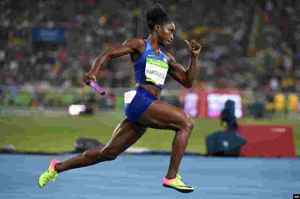 Tianna Bartoletta of the United States on her way to clinching victory in the women's 4 x 100-meter relay race.