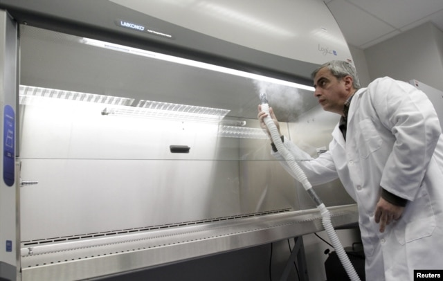 A technician demonstrates equipment during a media tour of a biological research facility built by the U.S. Defense Threat Agency in Tbilisi in 2011. (file photo)
