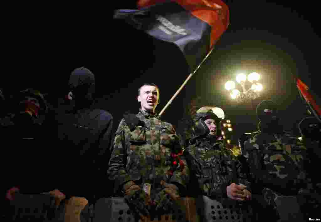 Activists from the Right Sector movement and their supporters gather outside Ukraine's parliament building to demand the immediate resignation of the interior minister in Kyiv on March 27. (Reuters/Vasily Fedosenko)
