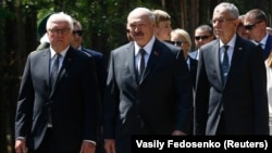 Belarusian President Alyaksandr Lukashenka (center) flanked by German President Frank Steinmeier (left) and Austrian President Alexander Van der Bellen (right) attend an unveiling ceremony for a monument to the victims of World War II on the grounds of the former Nazi concentration camp in Trostenets on June 29.