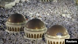 Saudi Arabia -- Muslim pilgrims pray at the Al-Masjid al-Haram (Grand mosque) in Mecca, 31Oct2011