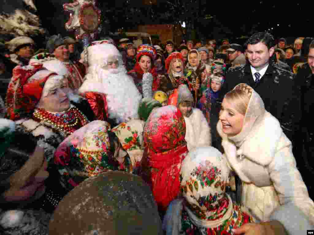 Ukrainian Prime Minister Yulia Tymoshenko greets people during Christmas celebrations in the city of Brovary. - Tymoshenko is now campaigning for the presidential election to be held on January 17. Photo by epa