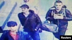 An image from a CCTV camera shows the three men believed to be the attackers walking inside the terminal building at Istanbul's Ataturk airport on June 28.