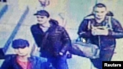A still image from CCTV camera shows the three men believed to be the attackers walking inside the terminal building at Istanbul airport on June 28.