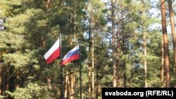 Russian and Polish state flags in fly at the site of the Katyn massacre in Smolensk, Russia.