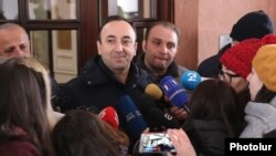 Armenia -- Constitutional Court Chairman Hrayr Tovmasian talks to reporters outside his home searched by law-enforcement officers, Yerevan, January 24, 2020.