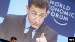 French President Nicolas Sarkozy speaks during the opening session of the 40th meeting of the World Economic Forum in Davos today.