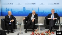 International Atomic Energy Agency chief Yukiya Amano (left to right), Iranian Foreign Minister Mohammad Javad Zarif, and Swedish Foreign Minister Carl Bildt participate in the Munich Security Conference in Munich, Germany, on February 2.