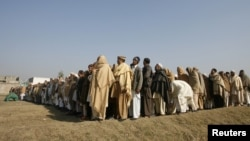 A funeral prayer is held in Swabi for Lubna Mahmood, 26, one of the aid workers who was killed by unidentified gunmen.