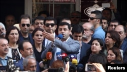 Selahattin Demirtas, co-leader of the pro-Kurdish Peoples' Democratic Party (HDP), speaks at a protest on October 27 against the arrest of two mayors in the predominantly ethnic-Kurd city of Diyarbaki for lleged links to terrorism.