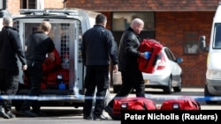 Inspectors from the Organisation for the Prohibition of Chemical Weapons (OPCW) arrive to begin work on March 21 at the scene of a nerve-agent attack on Russian ex-spy Sergei Skripal.