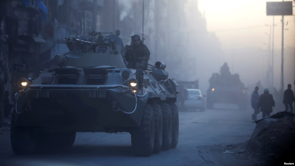 Russian soldiers patrol the recaptured rebel stronghold of Aleppo in Syria.