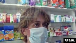 Armenia -- Employee of a drugstore in Yerevan wears a mask, Yerevan, 10Nov2009