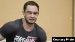 Казахстанский тяжелоатлет Денис Уланов.