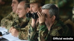 Nagorno Karabakh - Armenian President Serzh Sarkisian (R), watches military exercises in Karabakh, 13Nov2013