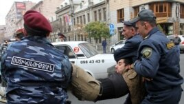 Armenia - Riot police detain a protester in Yerevan, 2Dec2013.