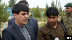 "Governor Mohammad Omer Safi (left) has blamed the fall of Kunduz on ""regional intelligence officials."" (file photo)"