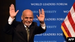 Afghanistan's President Ashraf Ghani gestures as he arrives to speak at Columbia University in New York on March 26.