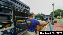 FBI Evidence Response Team on site after the shooting incident at a naval base in Pensacola, Florida.