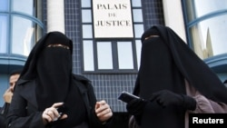 France, where these two women were protesting in September 2011, is among the countries to ban the full-face veil completely in public places.