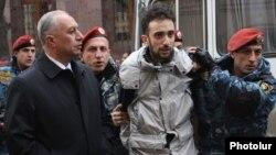 Armenia - Riot police detain a protester in Yerevan, 2Dec2013.