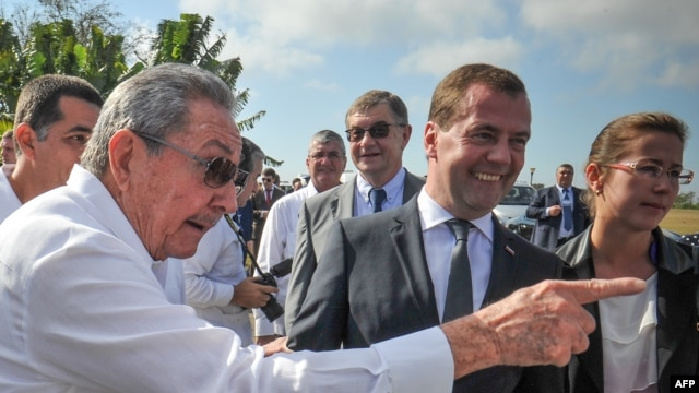 Cuban President Raul Castro (left) and Russian Prime Minister Dmitry Medvedev talk to journalists after a visit to the Soviet Soldier Monument in Havana on February 22.