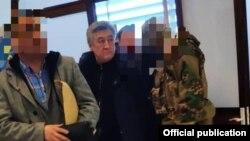 Адамкул Жунусовду Кыргызстанга алып келгенде тартылган сүрөт.