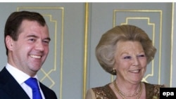 Russian President Dmitry Medvedev (left) meets with Dutch Queen Beatrix in The Hague.