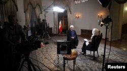 Iranian President Hassan Rohani sits for an interview in Tehran with Ann Curry of the U.S. television channel NBC on September 18.