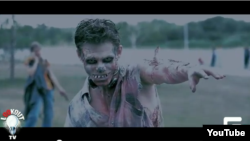 A screen shot from a video taken at the Zombie flash mob in Omsk on August 19.