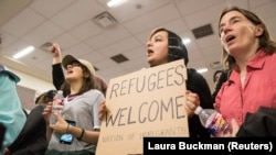 Protesters against the new policy at the international airport in Dallas, Texas, on January 29.