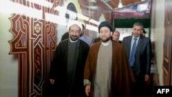 محمد کوثرانی (چپ) در کنار عمار حکیم از رهبران شیعه عراق در سال ۲۰۱۰