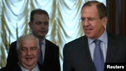 Syrian Foreign Minister Walid al-Moallem (left) with Russian Foreign Minister Sergei Lavrov (right) before a meeting in Moscow on January 17