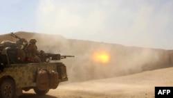 Гилменд уәлаятында «Талибан» шабуылына тойтарыс беріп жатқан ауғанстандық әскерилер. 9 қазан 2016 жыл.