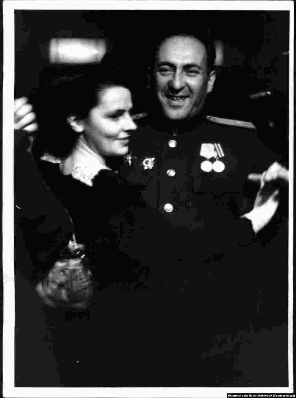 A Soviet information officer waltzing with a young woman.