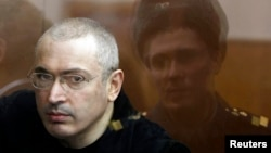 Jailed former oil tycoon Mikhail Khodorkovsky stands in the dock during a court session in Moscow in April 2010.