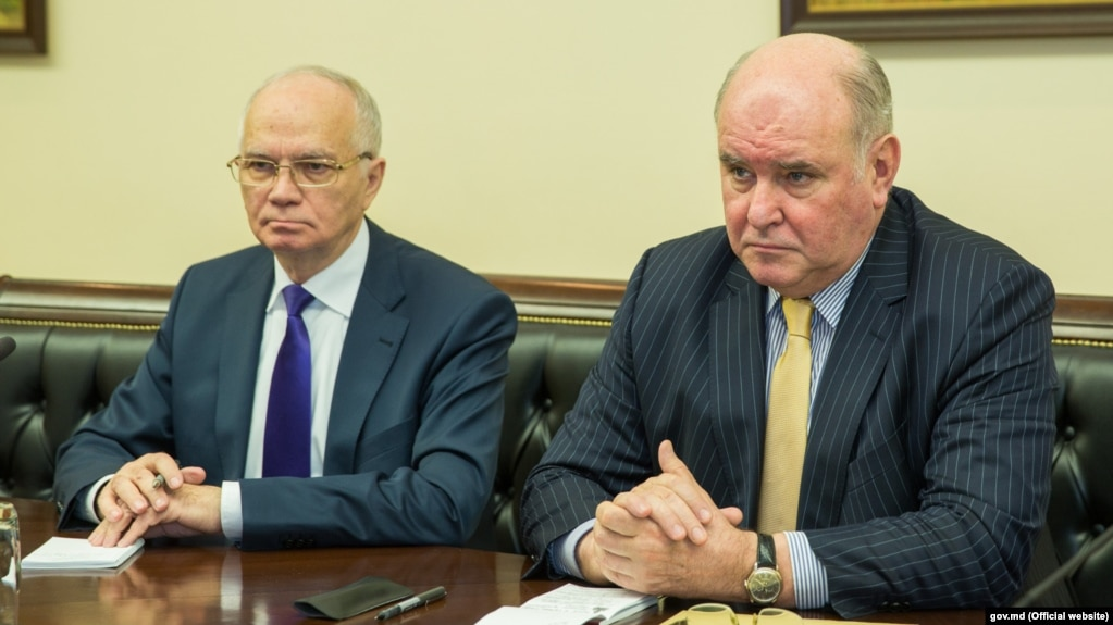 "Russian Deputy Foreign Minister Grigory Karasin (right) has vowed a ""tough"" response."