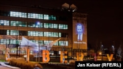 Czech Republic -- A portrait of Vaclav Havel is projected on the wall of the RFERL headquarters in Prague, 17Dec2012