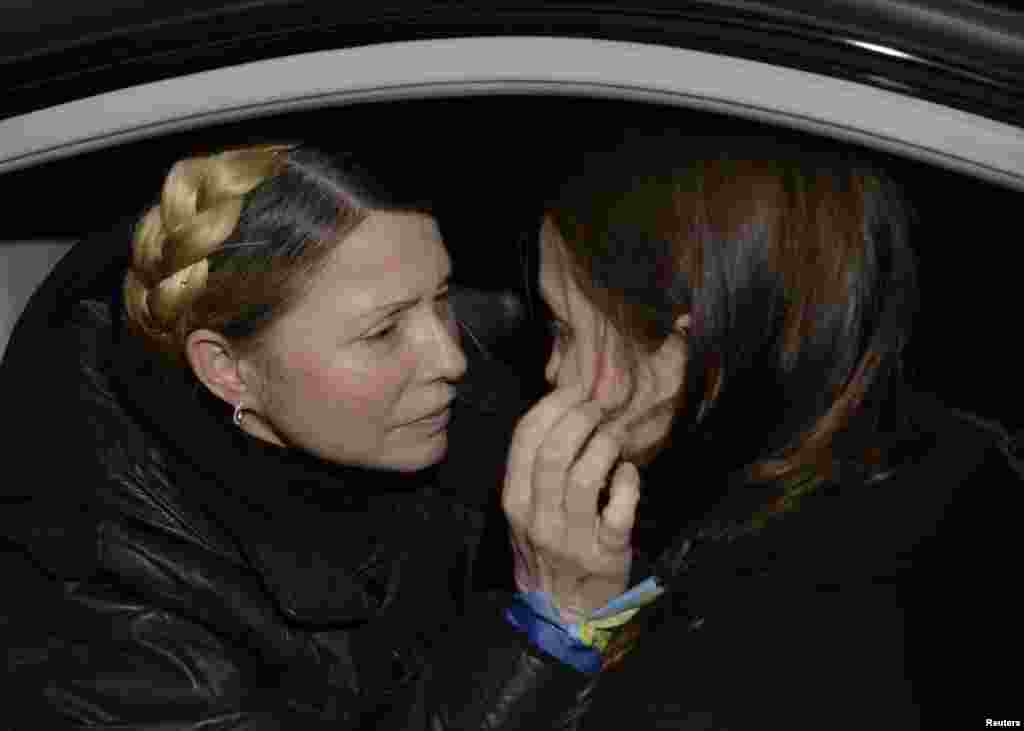 Tymoshenko hugs her daughter,Yevhenia,who fought long and hard for her mother's release.