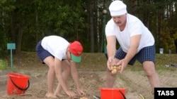 Belarusian President Alyaksandr Lukashenka: Have hat, will harvest.