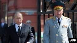 Russian President Vladimir Putin (left) and Colonel General Vladimir Chirkin attend a wreath-laying ceremony outside the Kremlin in Moscow in May.