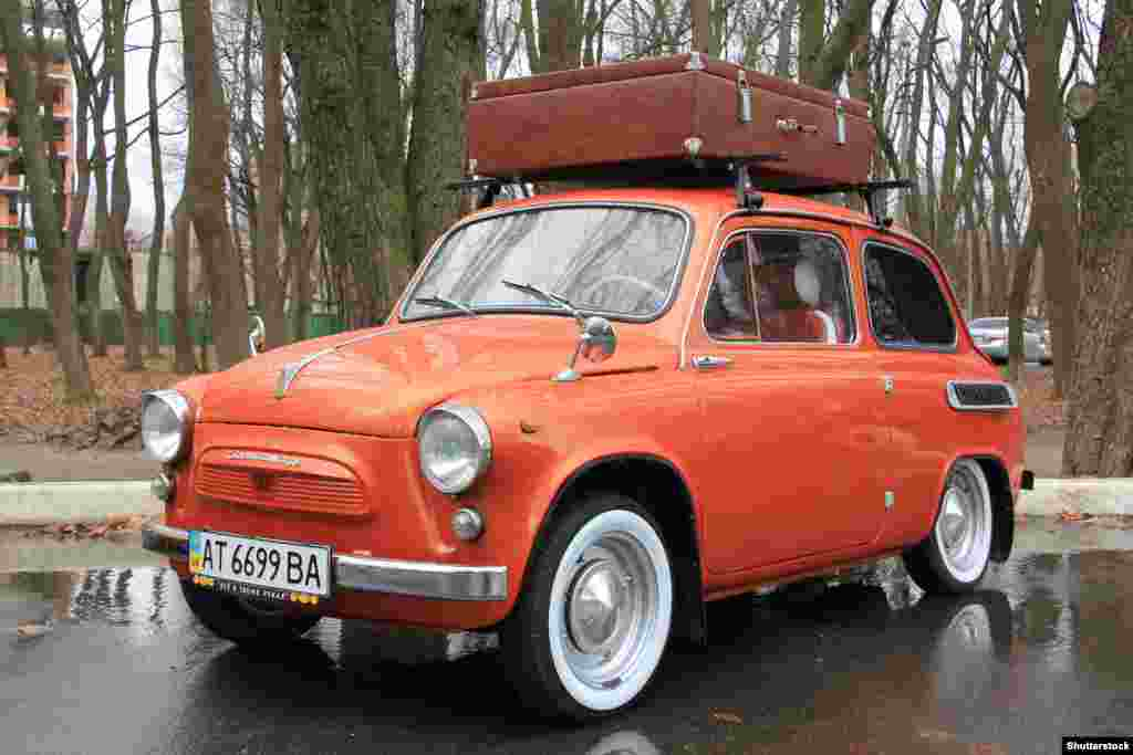 """In 1961, the Soviets came out with the ZAZ 965, a nearly identical copy of the Fiat, right down to the forward-opening""""suicide doors.""""By the 1960s Soviet designs were becoming more proletarian as an increasing number of ordinary Soviet citizens were able to get their own passenger cars, albeit after a lengthy wait."""