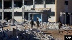 Сириянын өкмөттүк аскерлери Алепподо.