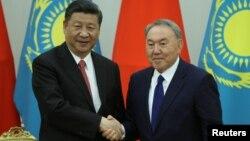 Қазақстан президенті Нұрсұлтан Назарбаев пен Қытай төрағасы Си Цзиньпин. Астана, 8 маусым 2017 жыл.