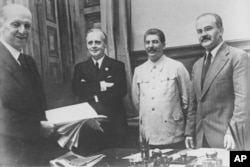 (Left to right:) German diplomat Friedrich Gaus, German Foreign Minister Joachim von Ribbentrop, Sovet leader Joseph Stalin, and Soviet Foreign Minister Vyacheslav Molotov in the Kremlin on August 23, 1939.