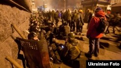 Thousands of protesters remain in a tense standoff with police on Kyiv's Independence Square, which has been the epicenter of antigovernment protests that began three months ago.