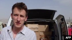 Abdul-Rahman (Peter) Kassig's family released this photo on October 4 showing him somewhere along the Syrian border between late 2012 and fall 2013 delivering supplies to refugees.