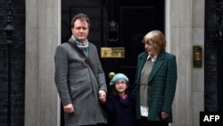 Richard Ratcliffe, husband of British-Iranian aid worker Nazanin Zaghari-Ratcliffe jailed in Tehran since 2016, his daughter Gabriella and his mother Barbara, pose outside of at 10 Downing Street in central London on January 23, 2020, to meet with Britain's Prime Minister. AFP
