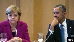 Гермнаия канцлері Ангела Меркель (сол жақта) мен АҚШ президенті Барак Обама.